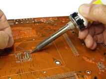 Soldering in progress Royalty Free Stock Photos
