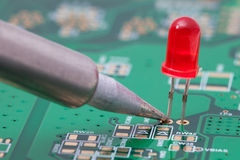 Soldering the red LED Royalty Free Stock Photos