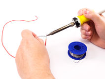 Soldering A Red Wire Royalty Free Stock Photos