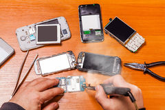 Soldering, repair broken phone Stock Image