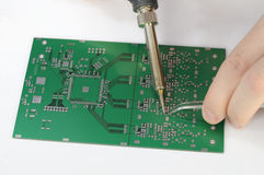 Soldering resistor to printed circuit board Stock Image