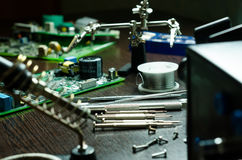 Soldering station with soft solder and tools Stock Photography