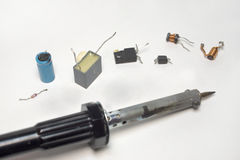 Soldering tool with several components of electronics in a row Royalty Free Stock Photo