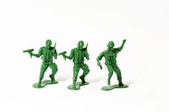 Solders. Three green plastic solders over the white Royalty Free Stock Photos