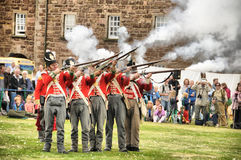 Solders firing muskets Stock Photography