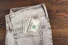 Soldi americani nella tasca dei jeans Fotografie Stock