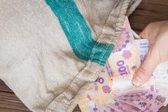 Soldi argentini nella borsa/su nelle denominazioni delle banconote Fotografia Stock
