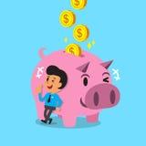Soldi dei guadagni dell'uomo del fumetto con il porcellino rosa Fotografie Stock Libere da Diritti