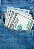 Soldi del dollaro in tasca Fotografia Stock