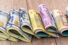 Soldi del mucchio: dollari e banconote degli euro Fotografia Stock