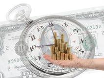 Soldi della tenuta della mano oltre una banconota di 50 dollari Fotografia Stock Libera da Diritti