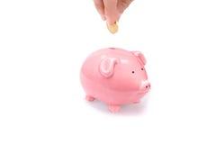 Soldi di risparmio con la banca piggy Immagine Stock