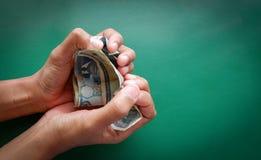 soldi di risparmio dei soldi del pacco Immagini Stock