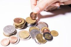 Soldi di risparmio | Fondo bianco Fotografie Stock