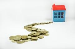 Soldi di risparmio per la casa Immagini Stock Libere da Diritti