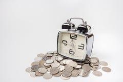 Soldi di risparmio in tempo fotografia stock