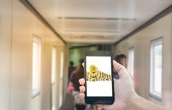 Soldi dorati della moneta mobile finanziaria di affari Fotografia Stock
