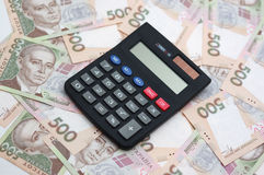 Soldi e calcolatore Immagine Stock