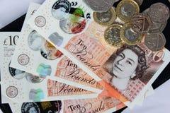 Soldi e monete inglesi Immagine Stock