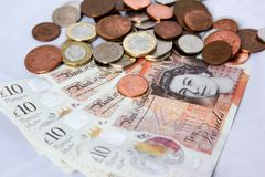 Soldi e monete inglesi Fotografia Stock
