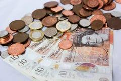 Soldi e monete inglesi Immagini Stock