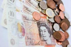 Soldi e monete inglesi Fotografie Stock Libere da Diritti