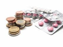 Soldi e pillole Fotografia Stock Libera da Diritti