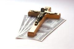 Soldi e religione Fotografie Stock Libere da Diritti