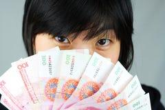 Soldi e soldi Immagine Stock