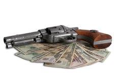 Soldi e una pistola sull'ovest selvaggio fotografia stock libera da diritti