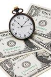 Soldi ed orologio Fotografia Stock