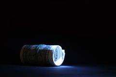 Soldi Illumined su oscurità Fotografie Stock Libere da Diritti