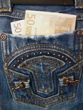 Soldi in jeans della casella Fotografia Stock Libera da Diritti
