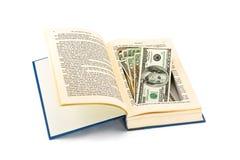 Soldi nascosti in un vecchio libro Fotografia Stock