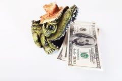 Soldi nella bocca del coccodrillo, dollari americani, USD fotografia stock libera da diritti