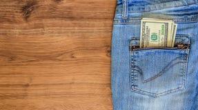 Soldi nella casella dei jeans Immagine Stock Libera da Diritti
