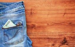 Soldi nella casella dei jeans Immagini Stock Libere da Diritti