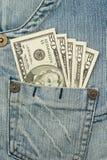 Soldi nella casella dei jeans Immagine Stock