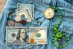 Soldi, orologio da tasca immagini stock libere da diritti