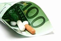 Soldi su medicina costosa senza beneficio Fotografie Stock Libere da Diritti