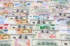 Soldi, varie valute come priorità bassa Fotografia Stock Libera da Diritti