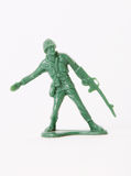 Soldier. Green toy soldier over white background. Photo royalty free stock image