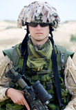 Soldier. In desert uniform holding his rifle royalty free stock image