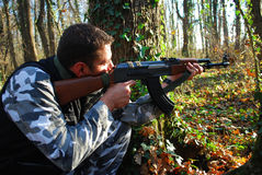 Soldier. In camouflage aiming with his rifle outdoor stock photography
