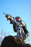 Soldier. In camouflage aiming with his rifle outdoor royalty free stock photo