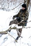 The soldier. Patrol and protection in winter wood. Snow stock image