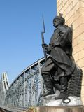 Soldier. Bronze soldier watching a bridge Royalty Free Stock Images