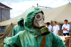Soldier. On studies on a civil defensive in a protective suit and gas-mask Royalty Free Stock Photos