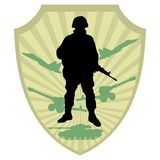 Soldier. Silhouette of soldier on military coat of arm background Stock Image