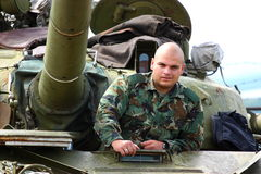Soldier. A soldier on (in) heavy military tank outdoor royalty free stock images